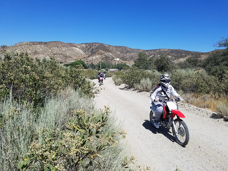 Group of people riding OHV motorcycles