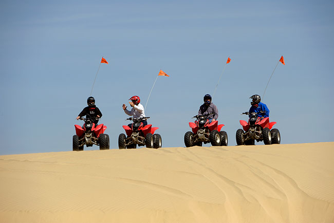 Four ATV's on the dunes