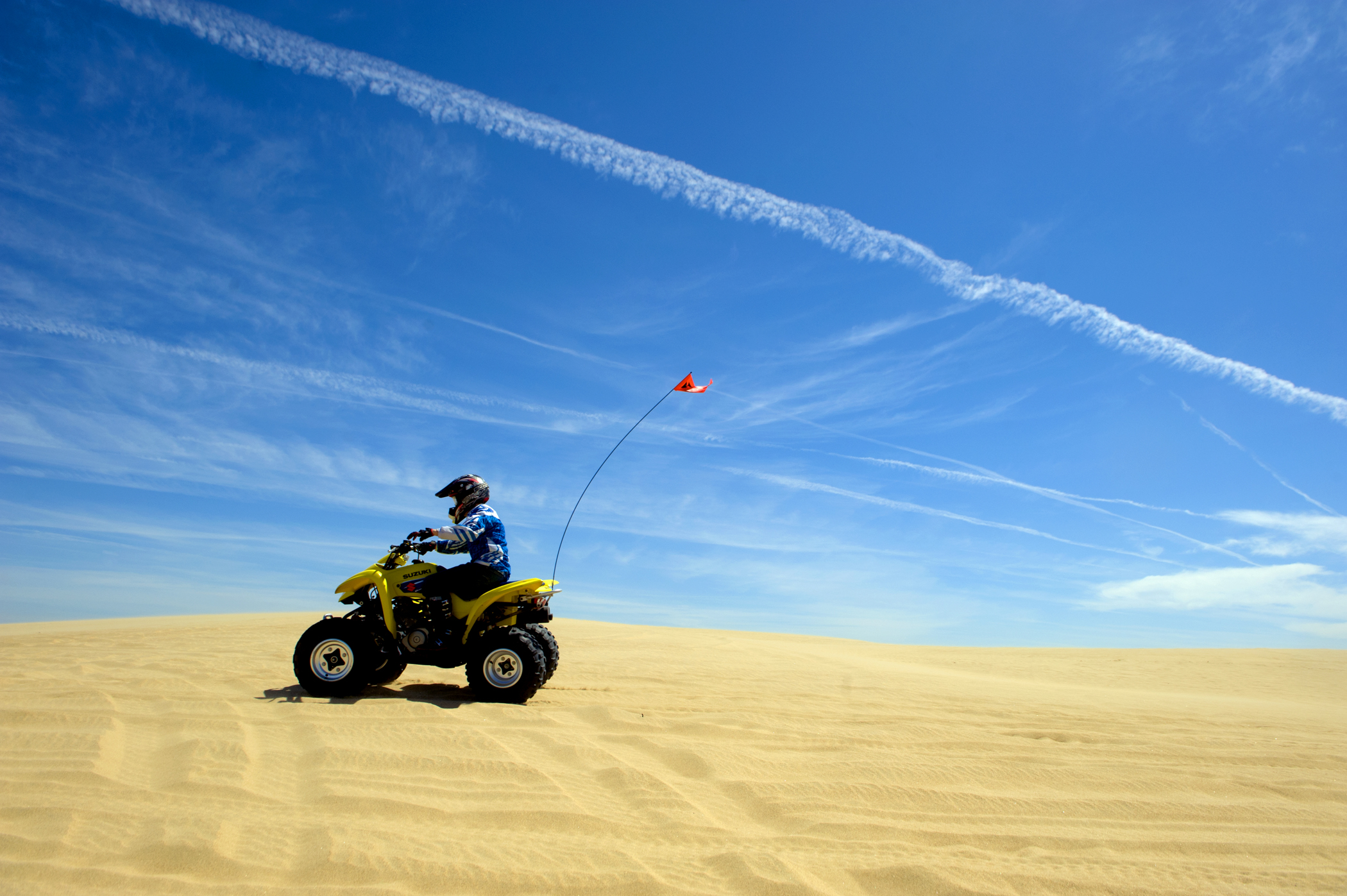 ATV riding on a dune